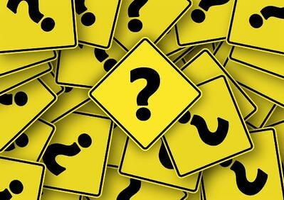 lot of paper with Question mark