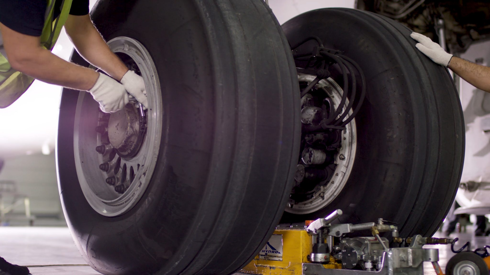 mechanics working on landing gear