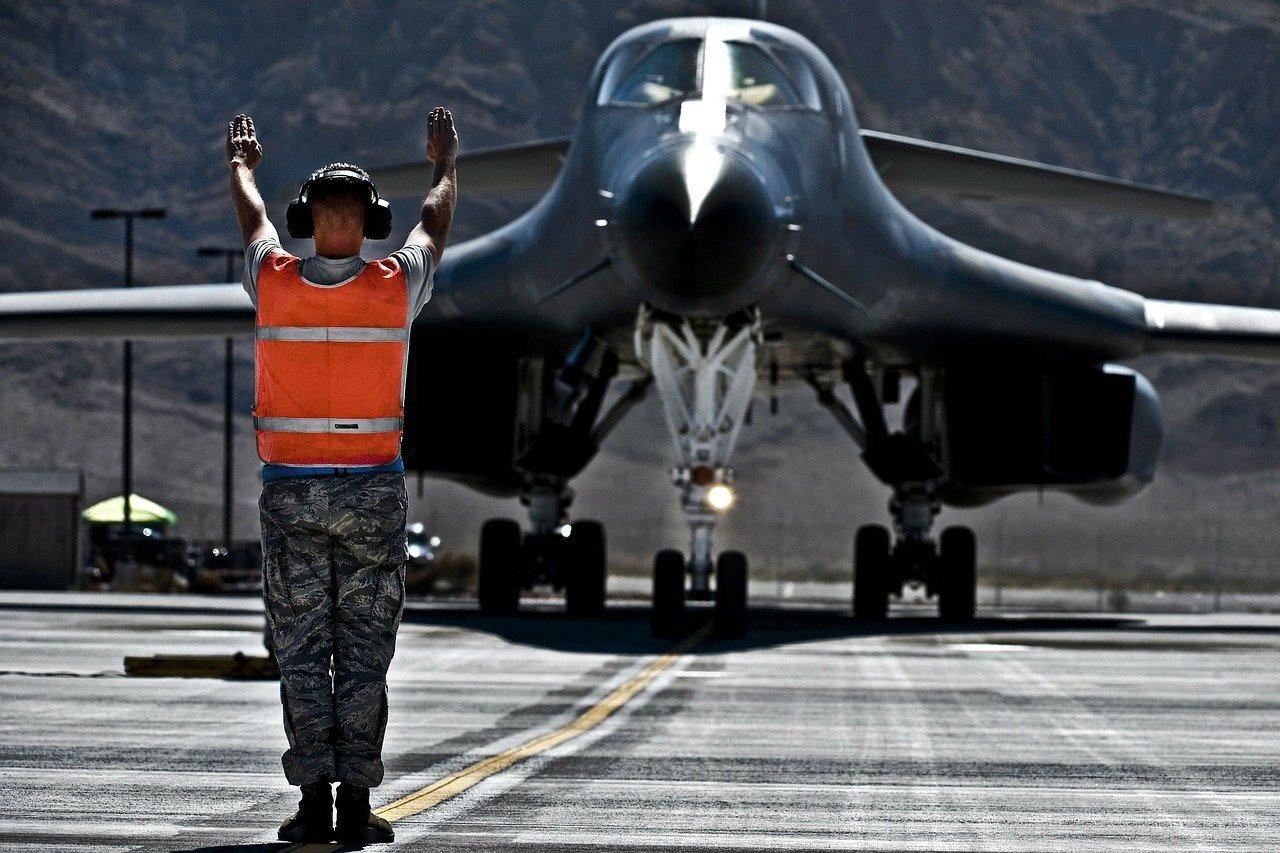 aviation marshaller directing aircraft