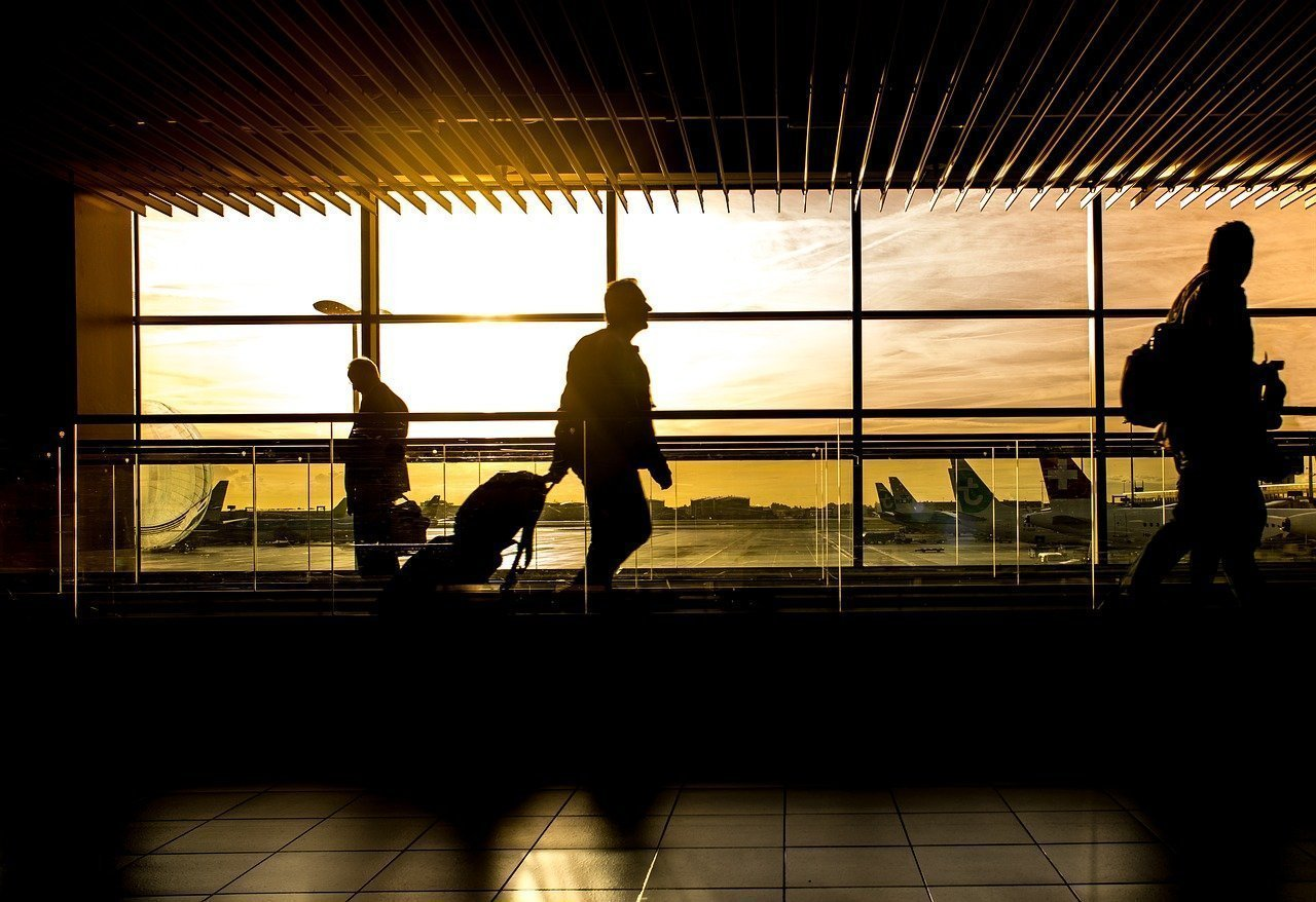 silhouettes of people in airport