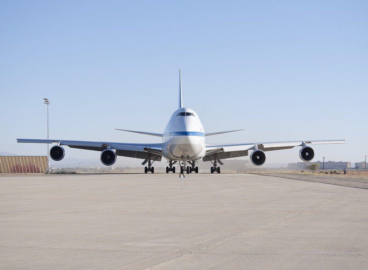 white airplane on runway